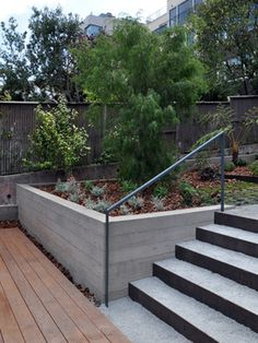 Retaining Wall handrail and stairs.  Set back six inches from sidewalk to allow for tall plants sandwiching stairs.