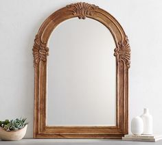 Mirrors help small spaces feel bigger and increase the light in a room. Find this Mendosa Arch Wood Mirror from Pottery Barn. Farmhouse charm wall decor and vintage-look mirror. Arch Mirror, Mirror Art, Wall Mirrors, Round Wood Mirror, Wood Arch, How To Clean Mirrors, Interior Decorating Styles, How To Antique Wood, Recycled Wood