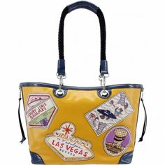 A glam and modern twist on antique luggage inspiration - this roomy tote is not only fashionable and fun to carry, the heavy canvas twill is coated so its beauty lasts.