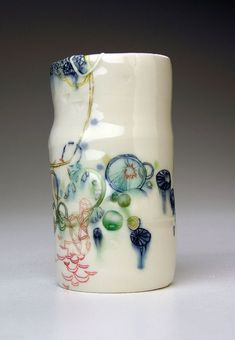 Michelle Summers -  says it is earthenware - but looks a bit like porcelain, cus its so transparent -