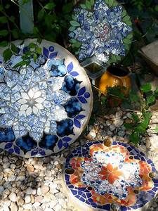Stepping stones made with broken china, plates, or pottery ...