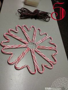 Today I& sharing a quick and easy Christmas craft that looks fabulous! DIY CANDY CANE WREATH My friend Vicki introduced me to the fini. Christmas Ornament Wreath, Easy Christmas Crafts, Christmas Candy, Simple Christmas, Christmas Art, Christmas Decorations, Christmas Ideas, Candy Cane Decorations, Snowflake Wreath