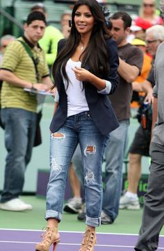 Kim Kardashian in destructed faded cuffed jeans. #jeans #destructed