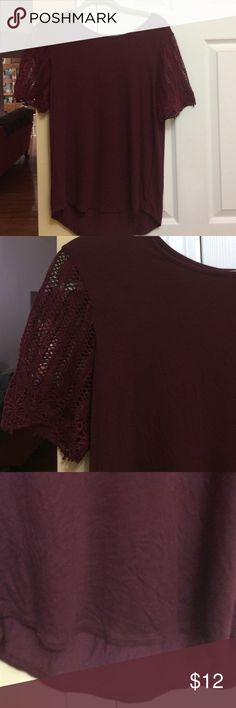 Loft burgundy top, with lacy sleeves. Medium Loft burgundy top with lacy sleeves, alittle longer in back.  Rayon, spandex, cotton.  Med. New w/o tags. Loft Tops