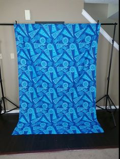 A Scary Fun Monsters University Party - couple if yards of fabric or wrapping paper for a photo op backdrop.