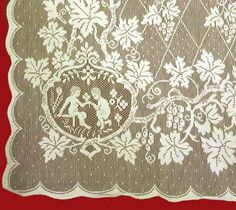 """Detail of our imported Scottish lace panels in the pattern named """"Cherubs""""."""