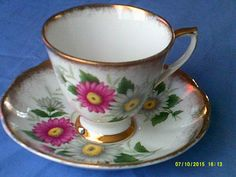 Vintage Roslyn Tea Cup and Saucer by BullwinklesAttic on Etsy
