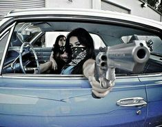 the revolver is not loaded but her finger is in the trigger well. This is how guns go off accidentally! Gangsta Tattoos, Chicano Tattoos, Chicano Art, Badass Tattoos, Catrina Tattoo, Cholo Style, Arte Hip Hop, Bmw Autos, Creation Art