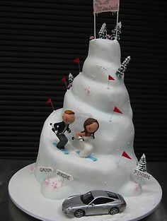 unusual funny wedding cake decor with skiing and mercedes