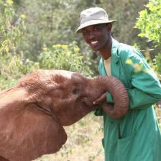 This is Lima Lima, our latest rescue looking healthier with keeper Adan. Read more about how Lima Lima is getting on at https://www.facebook.com/thedswt