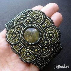 a beautiful beaded cuff by jagienkaa she has a blog on blogspot.