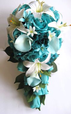 Need Calla Lily Wedding Theme Ideas? Have you considered sending out calla lily wedding invitations? Read on for more ideas and where to shop online for your wedding theme, see photos and get ideas today! Teal Bouquet, Cascade Bouquet, Teal Wedding Bouquet, Teal Wedding Flowers, Blue Orchids, Bridal Flowers, Wedding Bridesmaids, Turquoise Bouquet, Blue Flowers Bouquet