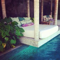 Pool overhung by a HUGE day bed, adorned with a stack of comfy pillows. I could lose hours here!!