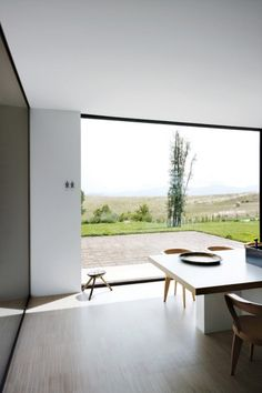 The great big window makes this space feel way more open than it is. Sweet idea and a beautiful view.