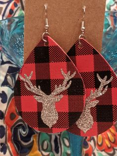 buffalo plaid (double sided) faux leather with silver glitter htv reindeer... super cute!!!  lead/nickel free hook Will bundle