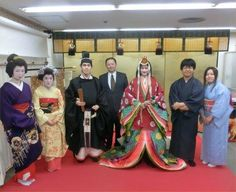 Men and women dressed in kimono including from the heian era.