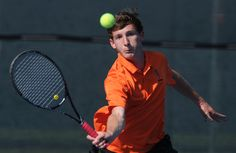 Ames' Andrew Ellis hits a shot during a singles match against Fort Dodge on Tuesday at Ames High School. Photo by Nirmalendu Majumdar/Ames Tribune  http://amestrib.com/sports/boys-tennis-ames-charging-districts-after-fort-dodge-win