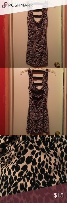 Charlotte Russe Cheetah Print Party Dress Cheetah print party dress from Charlotte Russe is the perfect dress for a night out. Dress has an open back with black elastic straps going down the back as seen in the picture. Made of 96% Polyester and 4% Spandex. Charlotte Russe Dresses Mini