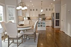adding small touches of coastal elements to the open kitchen keep it consistent