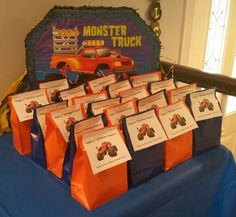 Blaze and the Monster Machines party favor bags. Orange and blue paper lunch bags + printed labels with a pic of Blaze. Easy to make.