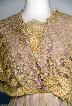 EMBROIDERED TEA GOWN, 1914-1918 Cream cotton net, floral embroidery, lilac underdress, excellent. Detail front
