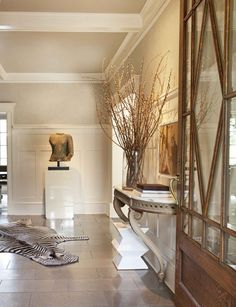 Make an Entrance. A zebra rug, French console table, and limestone floors. Interior Designer: Nam Dang-Mitchell.