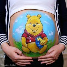 Winnie the Pooh The red and white brooch is a Moldovan symbol of spring called Mărțișor. Pregnancy Crafts, Pregnancy Art, Pregnancy Belly, Disney Face Painting, Bump Painting, Spider Man Face Paint, Winnie The Pooh, Pregnant Belly Painting, Belly Art