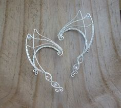 Hey, I found this really awesome Etsy listing at https://www.etsy.com/listing/237999040/elven-ear-cuffs-silver-elven-ear-cuffs