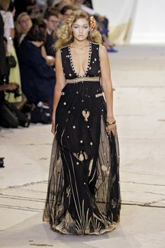 Pin for Later: Bella and Gigi Hadid Are Taking Over the Catwalks at NYFW Gigi glowed on the catwalk in a sheer maxi dress that featured a plunging neckline and gold embroidery. New York Fashion, Star Fashion, Runway Fashion, Fashion Show, Holiday Fashion, Fashion Styles, Sheer Maxi Dress, Sheer Gown, Diane Von Furstenberg