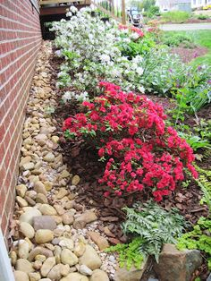 put rocks between bed and fence to save from weedeating....