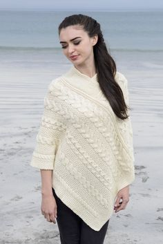 Aran Cable & Moss Poncho This Poncho features the traditional moss stitch as well as the popular cable design styled in a horizontal fashion. The Moss Stitch was said to suggest a good harvest. It depicts carrageen moss, a type of seaweed found on the western coast of Ireland which was used as a food and fertiliser of the barren fields of the island. This stitch is rarely used in isolation but rather used as a filler stitch in-between the more popular Aran Patterns.