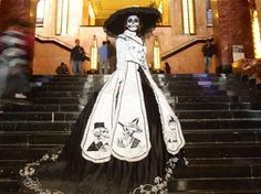 Another of Aguascalientes's regional dresses, this one has an emphasis on the artwork of native artist, Jose Guadalupe Posada. The embroidery features characters from Posada's woodcuts.