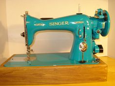 The 100% completed Miami Dolphins teal Singer 15-91 just prior to being picked up by her new owner. I thoroughly enjoyed this restoration and repaint and plan to keep it up with other vintage sewing machines. Wish me luck!!!!