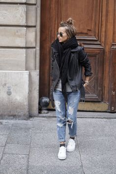 Camille Callen rocks the androgynous look in heavily distressed denim jeans, sneakers, and an authentic leather jacket. Jacket/T-Shirt/Sneakers: ASOS, Jeans: Sheinside.