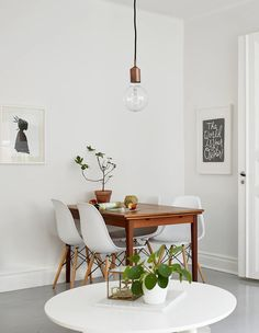 """Wooden table feels like a splash of """"colour"""" in this all-white dining space. Very Scandinavian"""