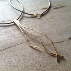 Gold leaf  necklace with a combination of  leather