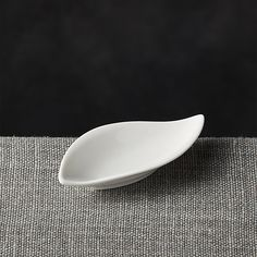 Resembling a leaf, this small sauce dish holds sauces or condiments in its curved shape, even pouring from its pointed tip.