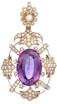 Victorian rose gold, amethyst and seed pearl pendant   Oval cut amethyst in an open detailed seed pearl surround.   L: 2 1/2 in, 13.3 dwt.
