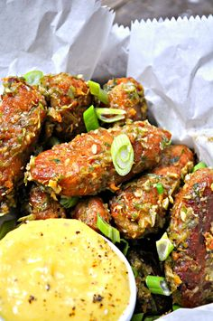Super crispy vegan hot wings made from chickpeas. Tossed in the most amazing jerk sauce and served with a sweet mango dipping sauce!