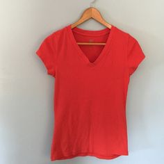 Orange V-Neck T Faded Glory orange v-neck t-shirt. Used condition, but no stains or tears! Faded Glory Tops Tees - Short Sleeve