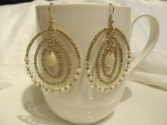 White and gold beaded multi hoop earrings. by DaisyLDK on Etsy, $24.00