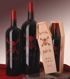 "Armida Winery ""Poizin"" wine.The detailed skull graphic is silk screened onto the dark bottle. The 'reserve' edition arrives in a wood coffin!"