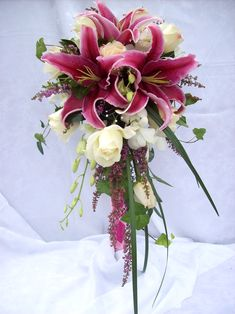 Stargazer lilies and whites roses in a traditional cascade bridal bouquet