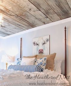 Love this bedroom - especially the barn wood plank ceiling! From The Heathered Nest
