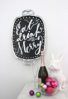 DIY CHALKBOARD SERVING TRAY FROM DARLING MAGAZINEFor those of you blessed with beautiful handwriting, this little tray DIY goes a long way in the name of festive decor. Hang it on the wall for decoration, or use it to serve up your ball droppin' cocktails.