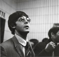 Image shows Paul McCartney during a press conference c. in 1966 photo by Günter Zint