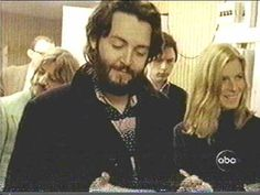 """Ringo Starr, Paul McCartney, and Linda Eastman (before marriage to Paul) listening to a track of """"Let it Be."""""""