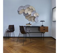 CLOUDS, by R. & E. Bouroullec   The two-sided tiles are linked together by elastic, allowing each installation to be totally unique--a modern art installation for the contemporary home.   Ligne Roset Home Accessories #LigneRoset #LuxuryWallArt #FrenchDesign #ModernHomeAccessories