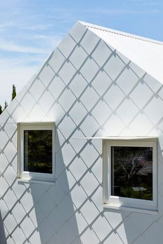 The only part of the home visible from the street is a pitched roof garage clad in white shingles that appears to be a modest dwelling. Lush Garden, Home And Garden, Recycled Brick, Glazed Walls, Brick Road, Australian Homes, Big Houses, Sustainable Design, Cladding