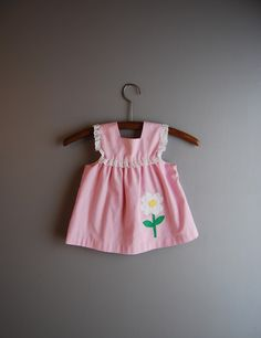 http://www.etsy.com/listing/70087480/vintage-1980s-pink-daisy-dress-2t?ref=sr_list_5&ga_search_query=dress&ga_noautofacet=1&ga_page=2&ga_search_type=vintage&ga_facet=vintage%2Fclothing%2Fgirl Vintage dress.  Back has square yoke and buttons.
